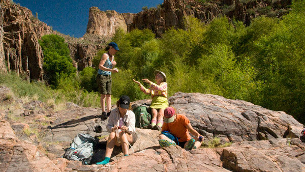 Photo of women backpacking in Aravaipa Canyon